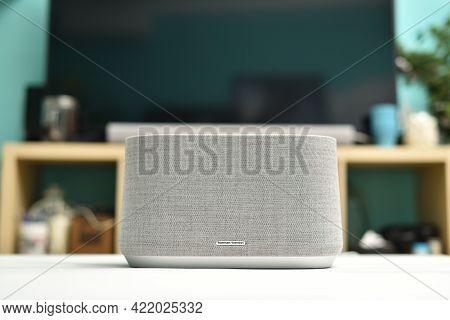 Stariy Oskol, Russia - May 19, 2021: Modern Wireless Bluetooth Speaker Harman Kardon On The Table In