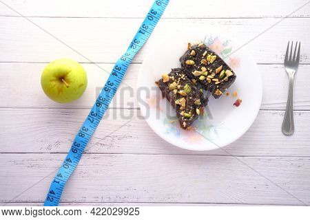 Comparing Apple And Brownie, Healthy Diet Concept