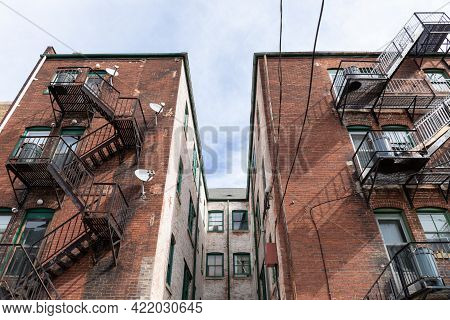Centered View Of A Light Well Between Apartment Building Wings, Metal Fire Escapes, Urban Housing Co