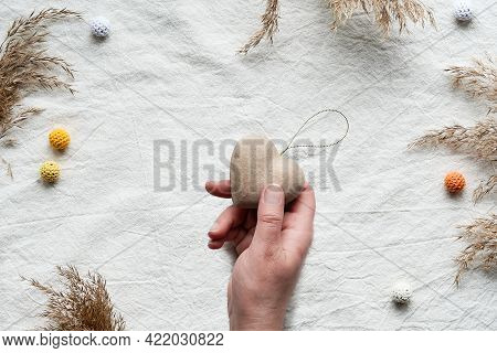 Textile Flat Lay With Dry Reeds, Pampas Grass. Hand Holds Soft Heart. Off White Cotton Tablecloth Ba