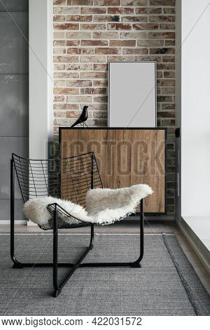 Vertical Shot Of Living Room Interior With Stylish Metal Chair On Carpeted Floor Opposite Panoramic