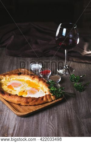 Flatbread With Yam And Cheese In The Restaurant. Dish With Wine And Herbs