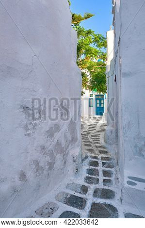 Traditional Narrow Cobblestone Streets, Beautiful Alleyways Of Greek Island Towns. Whitewashed Walls