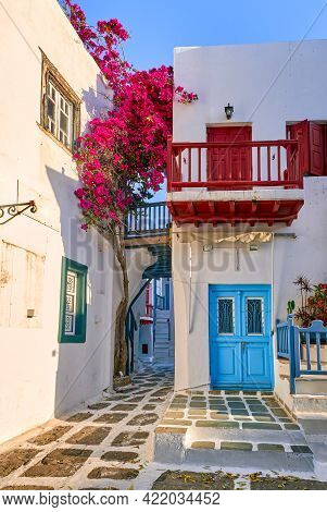 Traditional Narrow Streets, Beautiful Alleyways Of Greek Island Towns. Bougainvillea, White Houses,