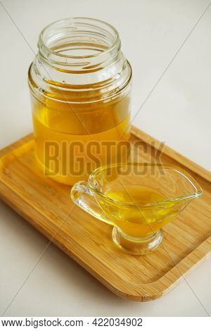 Freshly Made Liquid Homemade Ghee Butter Oil. Healthy Food Concept. Ayurveda Product