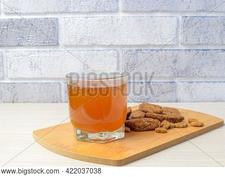 Glass With A Refreshing Drink, Crispy Croutons, Against The Background Of A Gray Brick Wall. Selecti