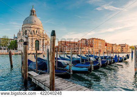 Gondolas And Santa Maria Della Salute Famous Church, Venice, Italy. High Quality Photo
