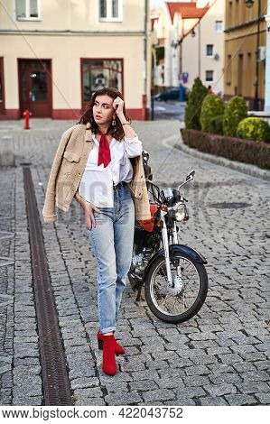 Young Beautiful Woman In Red Knitted Fabric Block Heel Sock Shoes, Blue Denim Jeans Pants And Teddy