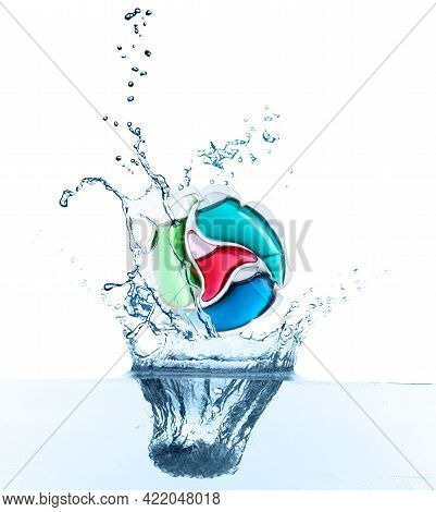 Laundry Capsule Falling Into Water On White Background. Detergent Pod