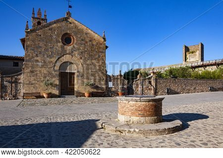 The Romansque Church Of Santa Maria Assunta On Rome Square In Monteriggioni, Italy