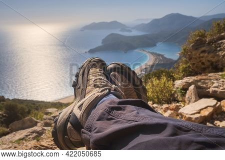 Hiker Feet In Trekking Boots On The Lycian Way  Over Oludeniz Blue Lagoon In Mugla Province, Fethiye