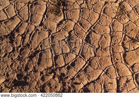Dry, Cracked Soil In The Desert. Close Up Texture.