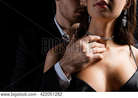 Cropped View Of Man In Black Blazer And White Shirt Sensually Holding Hand On Neck Of Seductive Woma