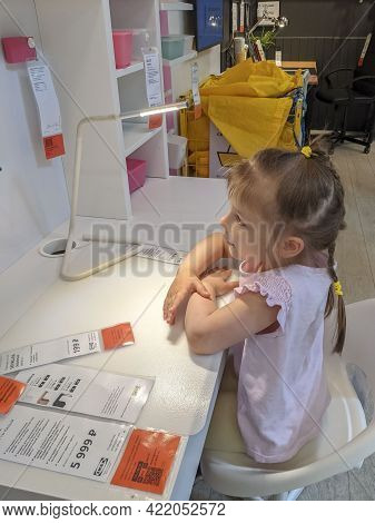 05.23.2021 Ikea, Moscow, Russia. Family Chooses Furniture In The Children's Room In The Store