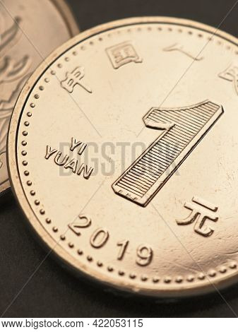 1 Chinese Yuan Coin Close Up. Yellow Or Light Brown Tinted Vertical Illustration About The Economy,