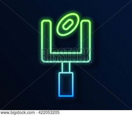 Glowing Neon Line American Football Goal Post And Football Ball Icon Isolated On Blue Background. Ve