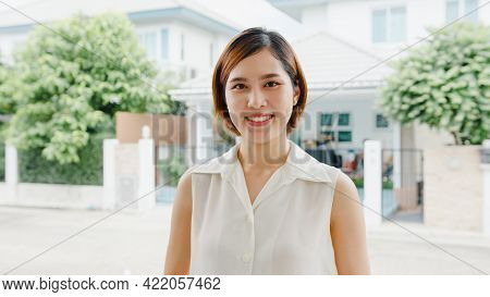 Happy Young Asian Female Feeling Happy Smiling And Looking To Camera While Relax On Street In Modern