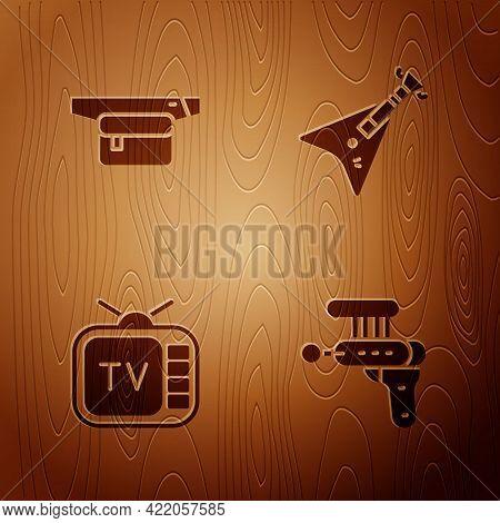 Set Ray Gun, Waist Bag Of Banana, Retro Tv And Electric Bass Guitar On Wooden Background. Vector