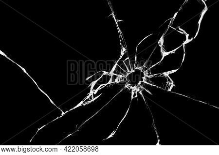 Cracked Glass Isolated On Black Background, Texture For Design, Window Shot Shattered Effect.