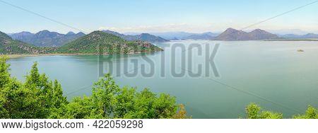Montenegro, Skadar Lake National Park. Beautiful Panoramic View Of Lake Skadar Surrounded By Mountai