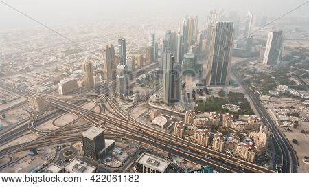 Dubai Skyline Along Sheikh Zayed Road At Sunset. Aerial View Of Downtown City Highway From Above. Br
