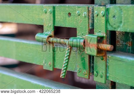 Homemade Latch Welded From Reinforcement And Painted With Green Paint.