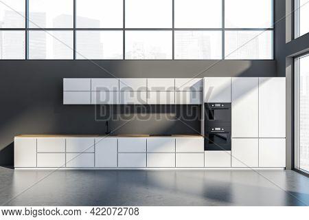 Dark Grey Cooking Room Interior, Front View. Grey Minimalist Modern Kitchen With Concrete Floor, Win