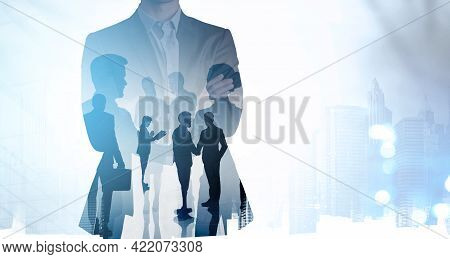 Businessman In Suit In Crossed Arms Pose. Silhouettes Of Business Partners, Double Exposure Of Peopl