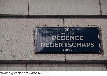 Brussels, Belgium - August 16, 2019: Street Name Signs On Rue De La Regence In Brussels, The Capital