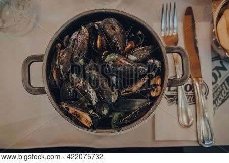 Brussels, Belgium - August 17, 2019: Pot Of Mussels On A Table Inside Chez Leon, A Family-owned Rest