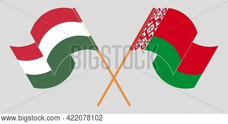 Crossed And Waving Flags Of Belarus And Hungary