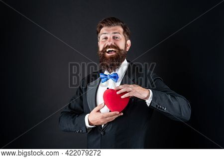 Handsome Man In Tuxedo Holding Love Gift Of Heart For Valentines Day, Valentine