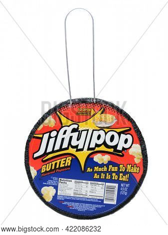 IRVINE, CA - DECEMBER 12, 2013: A package of Jiffy Pop Popcorn. Jiffy Pop combines popcorn kernels, oil, and flavoring with a expandable aluminum foil pan and a light-gauge aluminum foil cover.