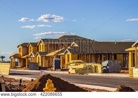 Row Of New Homes Under Construction In Late Afternoon Sun