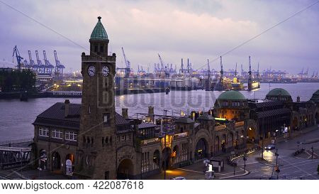 Famous St Pauli Landungsbruecken At The Port Of Hamburg - Amazing Evening View - Hamburg, Germany -