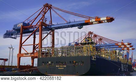 Container Vessel At The Terminal Of The Port Of Hamburg - Hamburg, Germany - May 10, 2021