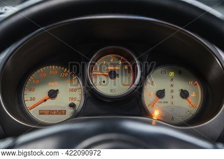 Novosibirsk, Russia - May 29, 2021:toyota Rav-4,   Car Dashboard With Yellow  Backlight: Odometer, S