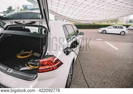 Wolfsburg, Germany - June 19, 2016: Volkswagen Vw E-golf Charge Cable In The Charging Panel An Elect