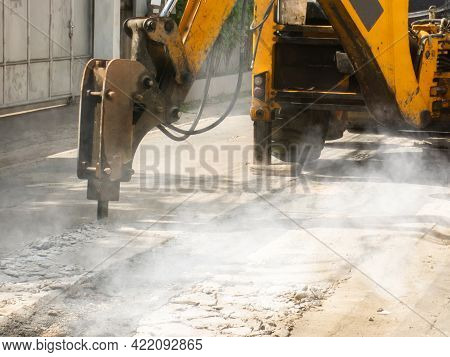 Machine Is Working To Drill The Concrete Pavement Causing Dust Smoke And Noise Pollution The Operati