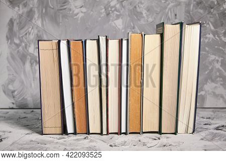 Stack Of Colorful Books. An Open Book On A Stack Of Books. The Concept Of Education, International B
