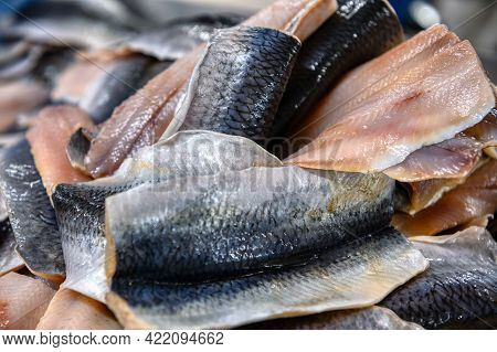 Fillet Of Atlantic Herring. Fillet With Skin. Seafood Production.