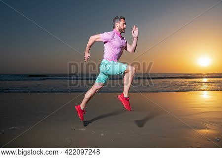 Man Running At Sunset. Full Length Of Healthy Man Running And Sprinting Outdoors. Male Runner. Fit M