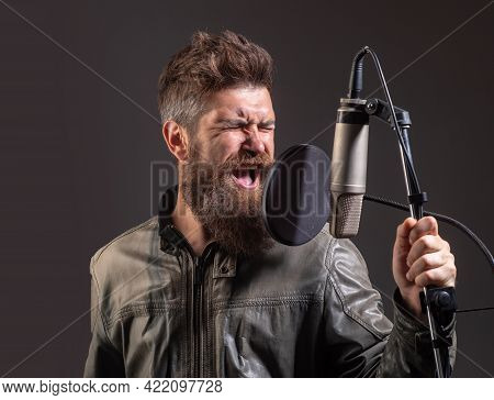 Expressive Singer With Microphone. Handsome Man In Recording Studio. Music Performance Vocal. Singer