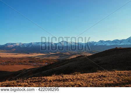 Awesome Autumn Landscape With Tourists Crowd On Hill With View To Red Valley And Great Snow-covered