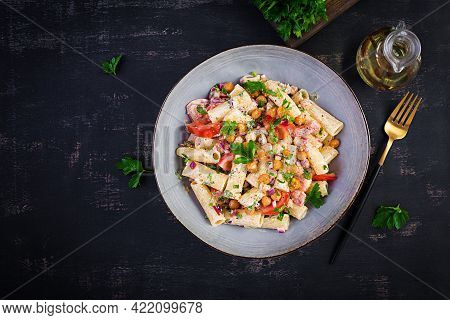 Vegetarian Vegetable Pasta. Pasta Rigatoni With Tomato, Red Onion, Parsley And Fried Chickpeas With