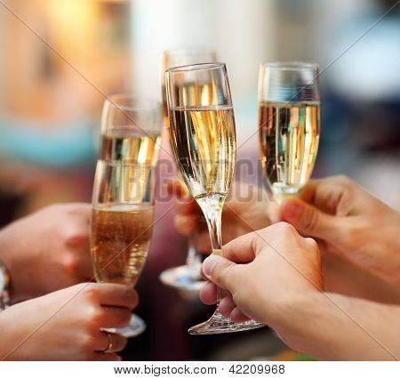 Celebration. People Holding Glasses Of Champagne