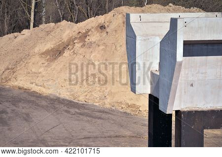 Concrete Monolithic Platform Of The Railway Bridge On Metal Supports Close-up On The Background Of T