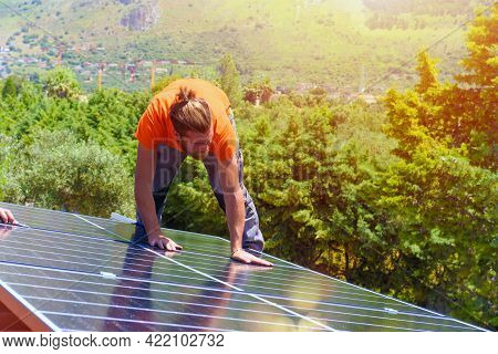 Workers Assemble Energy System With Solar Panel For Electricity