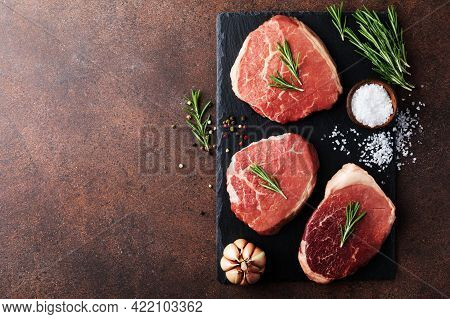 Raw Fresh Beef Meat On Slate Black Plate. Top View Flat Lay With Copy Space