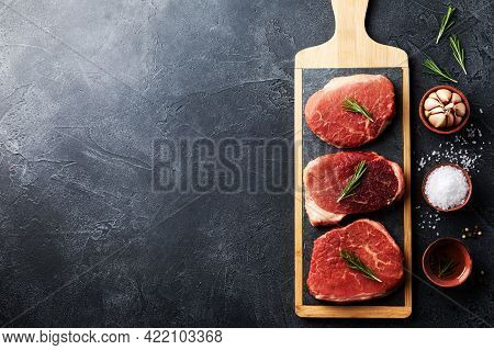 Raw Beef Meat On Kitchen Board. Top View Flat Lay With Copy Space